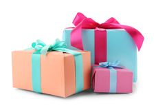 Beautiful gift boxes with ribbons. On white background royalty free stock image