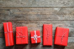 Beautiful gift boxes on wooden background. Top view Royalty Free Stock Image