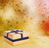 Beautiful Gift gold box with bow Stock Photo