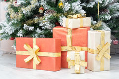 Beautiful gift lies near the Christmas tree Royalty Free Stock Photography