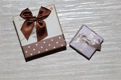 Gift for the new year. Beautiful gift for the new year under the tree Royalty Free Stock Photo