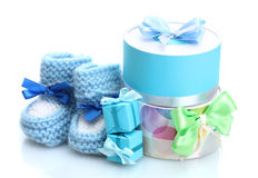 Beautiful gifts and baby's bootees Royalty Free Stock Images