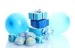 Beautiful gifts, baby's bootees and balloons Royalty Free Stock Photos