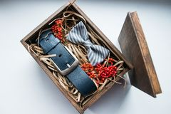 Beautiful gifts, a belt and a bow tie Stock Image