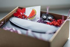 Beautiful gifts, a purse, cosmetics and a brooch Royalty Free Stock Photography