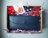 Beautiful gifts, a purse, cosmetics and a brooch Stock Photos