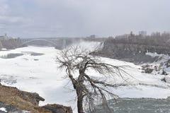 Beautiful gigantic frozen Horseshoe Niagara Waterfalls on a frozen spring day in Niagara Falls in Ontario, Canada. Beautiful gigantic frozen Horseshoe Niagara Royalty Free Stock Photography