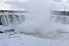 Beautiful gigantic frozen Horseshoe Niagara Waterfalls on a frozen spring day in Niagara Falls in Ontario, Canada. Beautiful gigantic frozen Horseshoe Niagara Stock Photos