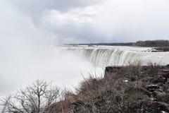 Beautiful gigantic frozen Horseshoe Niagara Waterfalls on a frozen spring day in Niagara Falls in Ontario, Canada. Beautiful gigantic frozen Horseshoe Niagara Stock Images