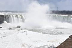 Beautiful gigantic frozen Horseshoe Niagara Waterfalls on a frozen spring day in Niagara Falls in Ontario, Canada. Beautiful gigantic frozen Horseshoe Niagara Royalty Free Stock Images