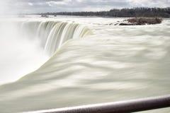 Beautiful gigantic frozen Horseshoe Niagara Waterfalls on a frozen spring day in Niagara Falls in Ontario, Canada. Beautiful gigantic frozen Horseshoe Niagara Stock Photo