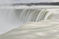 Beautiful gigantic frozen Horseshoe Niagara Waterfalls on a frozen spring day in Niagara Falls in Ontario, Canada. Beautiful gigantic frozen Horseshoe Niagara Royalty Free Stock Photos