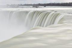 Beautiful gigantic frozen Horseshoe Niagara Waterfalls on a frozen spring day in Niagara Falls in Ontario, Canada. Beautiful gigantic frozen Horseshoe Niagara Royalty Free Stock Image