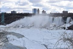 Beautiful gigantic frozen Niagara Waterfalls on a frozen spring day in Niagara Falls in Ontario, Canada. Beautiful gigantic frozen Niagara Waterfalls on a frozen Royalty Free Stock Image