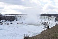 Beautiful gigantic frozen Niagara Waterfalls on a frozen spring day in Niagara Falls in Ontario, Canada. Beautiful gigantic frozen Niagara Waterfalls on a frozen Stock Photography