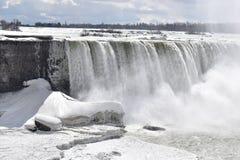 Beautiful gigantic frozen Niagara Waterfalls on a frozen spring day in Niagara Falls in Ontario, Canada. Beautiful gigantic frozen Niagara Waterfalls on a frozen Royalty Free Stock Photo