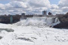 Beautiful gigantic frozen Niagara Waterfalls on a frozen spring day in Niagara Falls in Ontario, Canada. Beautiful gigantic frozen Niagara Waterfalls on a frozen Stock Photos