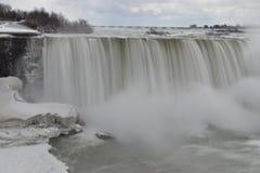 Beautiful gigantic frozen Niagara Waterfalls on a frozen spring day in Niagara Falls in Ontario, Canada. Beautiful gigantic frozen Niagara Waterfalls on a frozen Royalty Free Stock Photography