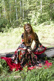 A beautiful ginger-haired girl. In gipsy suit royalty free stock photos