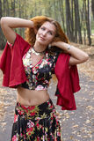 A beautiful ginger-haired girl. In gipsy suit royalty free stock images