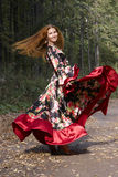 A beautiful ginger-haired girl in gipsy suit. In dance whirlwind royalty free stock images