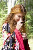 A beautiful ginger-haired girl in gipsy suit Royalty Free Stock Images