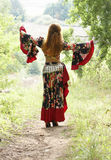 A beautiful ginger-haired girl in gipsy suit Royalty Free Stock Image