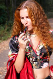 A beautiful ginger-haired girl in gypsy suit Royalty Free Stock Photos