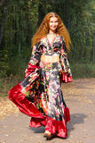 Beautiful ginger-haired girl in gypsy suit Royalty Free Stock Image