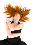 Beautiful ginger-haired woman lying on the floor Stock Images