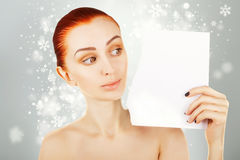 Beautiful ginger haired woman watches blank paper,christmas gift Stock Images