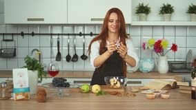 Beautiful Ginger Woman Food Preparation in Kitchen. Red head girl. stock video