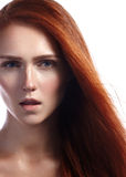 Beautiful ginger young woman with flying hair and naturel makeup. Beauty portrait of sexy model with straight red hair Stock Photos
