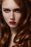 Beautiful ginger young woman with luxury hair style and fashion gloss makeup. Beauty closeup sexy model with red hair Royalty Free Stock Photography