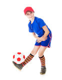 Beautiful gir with a ball. Beautiful girl in a sports cap and a T-shirt with a ball on a white background Royalty Free Stock Photos