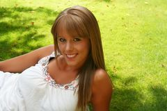 Beautiful girl. Beautiful blond girl lying on the grass Stock Photography