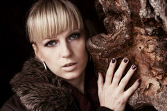 Beautiful girl. Portrait of beautiful girl leaning on a rock Royalty Free Stock Image