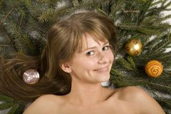 Beautiful girl. And a branch of christmas tree royalty free stock photography