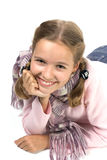 Beautiful girl. Cheerful girl in a pink blouse with a scarf Royalty Free Stock Photo