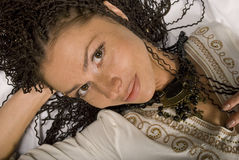 Beautiful girl. The lying beautiful girl with the African plaits Stock Photography