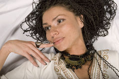 Beautiful girl. The lying beautiful girl with the African plaits Royalty Free Stock Image