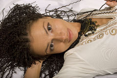 Beautiful girl. The lying beautiful girl with the African plaits Royalty Free Stock Photography