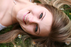 Beautiful Girl. Lays back with her hair in the grass Stock Photography