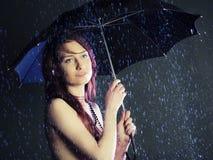Beautiful girl. Beautiful young girl under a rain Stock Images