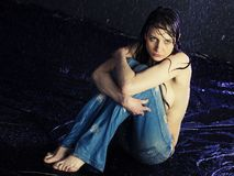 Beautiful girl. Beautiful young girl under a rain Royalty Free Stock Images