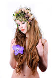Beautiful girl. Shy beautiful girl with long blond hair, flowers and shells isolated on white background Royalty Free Stock Photography