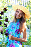 Beautiful girl. Next to mallow on a light background Stock Photography