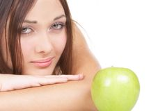 The beautiful girl. The girl with a green apple Stock Photo