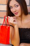 The beautiful girl. The girl holds a package on a finger Royalty Free Stock Images