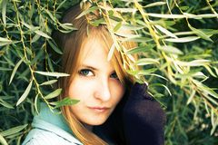 Beautiful girl. Among green leaves Stock Photos